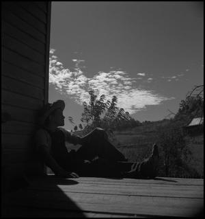 Primary view of object titled '[Boy on a porch]'.