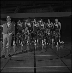 Primary view of object titled '[Basketball team setting up for photograph]'.