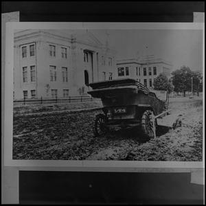 Primary view of object titled '[Car stuck in mud in front of Library Building, ca. 1913]'.