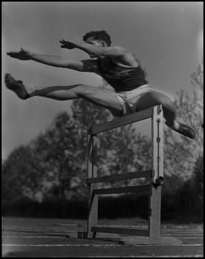 Primary view of object titled '[Student Jumping Hurdle]'.