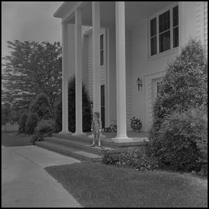 Primary view of object titled '[President's House with little girl on porch]'.