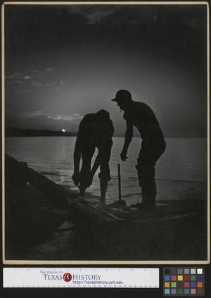 Primary view of object titled '[Two men working at sunset]'.