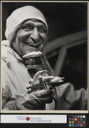 Primary view of object titled '[Worker painting a car]'.