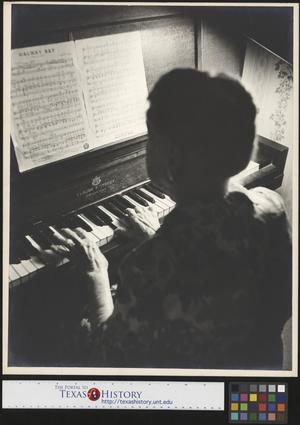 Primary view of object titled '[Miss Mary Bobo Playing Piano (1)]'.