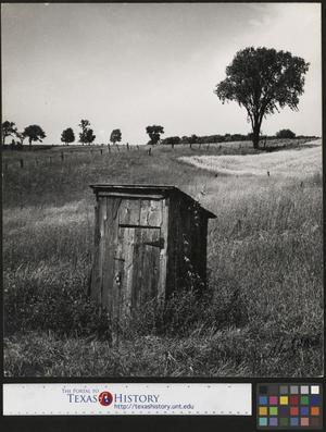 Primary view of object titled '[Outhouse in an Open Field]'.