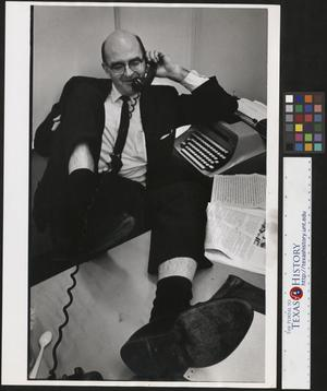 Primary view of object titled '[Businessman on the phone]'.