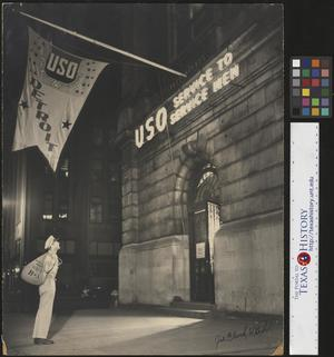 Primary view of object titled '[Man at the USO Building]'.