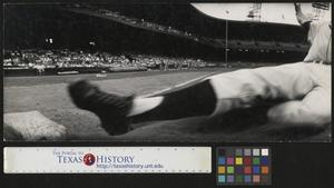 Primary view of object titled '[Unidentified baseball player slides into third base]'.