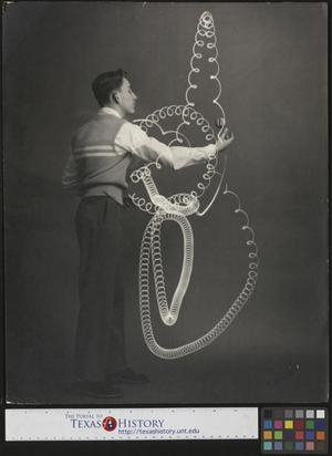 Primary view of object titled '[Man Performing a Yo-Yo Trick]'.