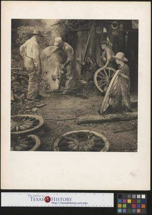 Primary view of object titled '[Building wagon wheels]'.