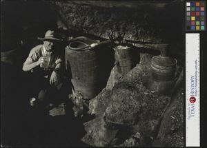 Primary view of object titled '[Joe Clark holding a quart jar full of moonshine]'.