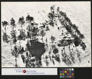 Primary view of object titled '[Aerial photograph of a snow covered home]'.