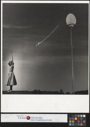 Primary view of object titled '[Ann Marston fires an arrow at an egg]'.