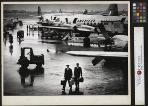 Primary view of object titled '[Pilots returning from their flight]'.
