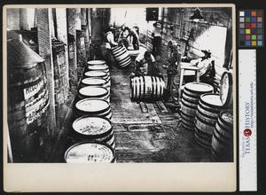 Primary view of object titled '[Men Working at Jack Daniel's Distillery]'.