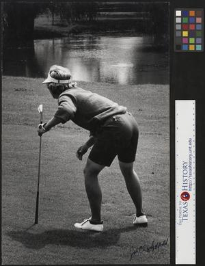 Primary view of object titled '[Golfer prepares for next shot]'.