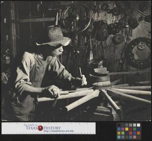 Primary view of object titled '[Alex Cline measuring a wheel]'.