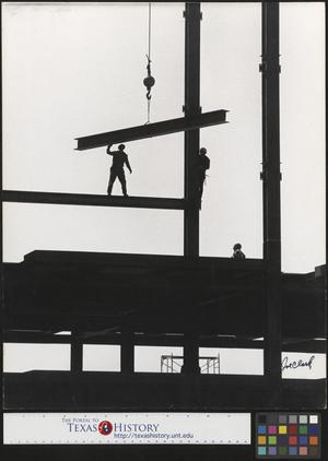 Primary view of object titled '[Construction workers set steel I beam]'.