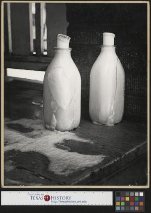 Primary view of object titled '[Frozen Milk Bottles]'.