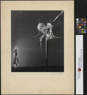 Primary view of object titled '[Ann Marston scrambles an egg with her bow and arrow]'.