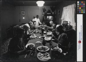 Primary view of object titled '[People Gathered Around Dinner Table]'.