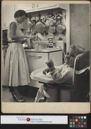 Primary view of object titled '[Mother pours milk while baby waits]'.
