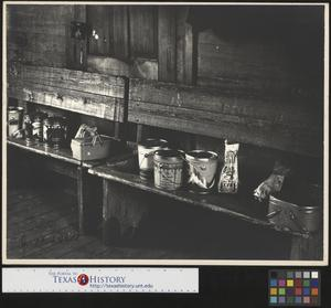 Primary view of object titled '[Lunch Buckets and Baskets on School Room Bench]'.