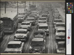 Primary view of object titled '[Traffic in snow covered Detroit]'.