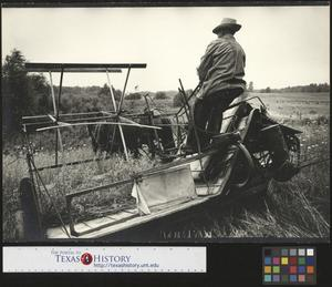 Primary view of object titled '[Threshing at Bud Guest's Farm]'.