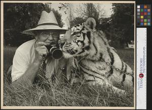 Primary view of object titled '[Joe Clark HBSS laying next to a tiger]'.