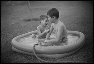 Primary view of object titled '[Brothers, Byrd and Tim, in a pool]'.