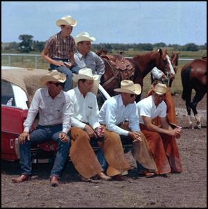 Primary view of object titled '[Cowboys taking a break]'.