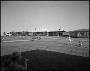 Primary view of object titled '[Children playing outside]'.