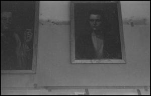 Primary view of object titled '[Portraits mounted on a wall]'.