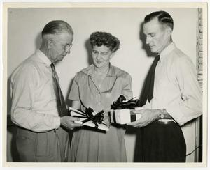 Primary view of object titled '[Fowler, Babb, and Hannah with gifts]'.