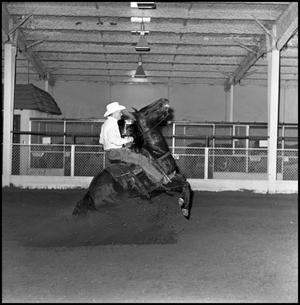 Primary view of object titled '[Close up of cowboy riding in the Cutter Bill Arena]'.
