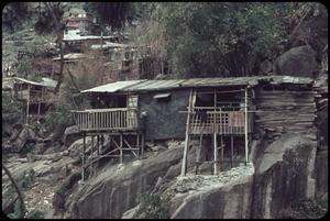 Primary view of object titled 'Hong Kong housing - shacks by Tiger Balm'.