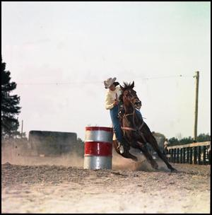 Primary view of object titled '[Woman barrel racing]'.