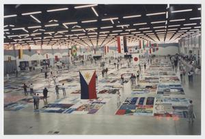 Primary view of object titled '[Photo: Memorial quilts display]'.
