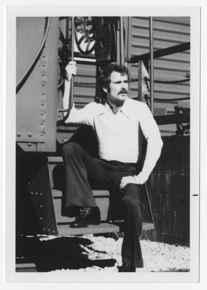 Primary view of object titled '[Bill Nelson sitting on metal steps]'.
