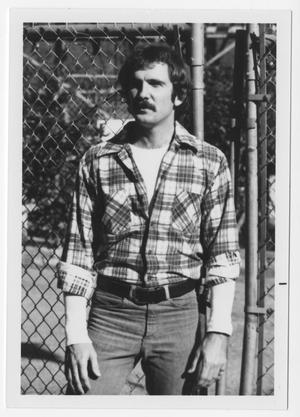 Primary view of object titled '[Bill Nelson in front of fence]'.