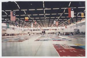 Primary view of object titled '[Photo: Memorial quilts and flags]'.