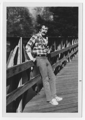 Primary view of object titled '[Bill Nelson leaning against a bridge]'.