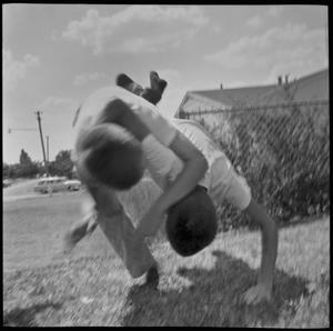 Primary view of object titled '[Boys fighting]'.
