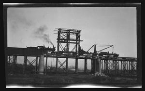 Primary view of object titled '[A train moving over a bridge]'.