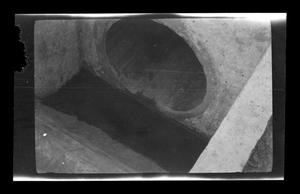 Primary view of object titled '[Photo of a sewage pipe]'.