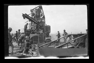 Primary view of object titled '[Construction workers and heavy machinery]'.