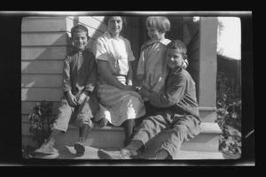 Primary view of object titled '[Irene Biffle Williams sitting on a porch with her sons]'.