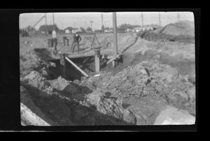Primary view of object titled '[Men working on a construction site]'.