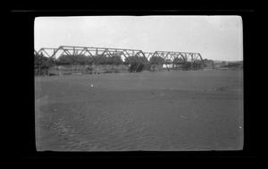 Primary view of object titled '[Photo of men working on a metal bridge]'.